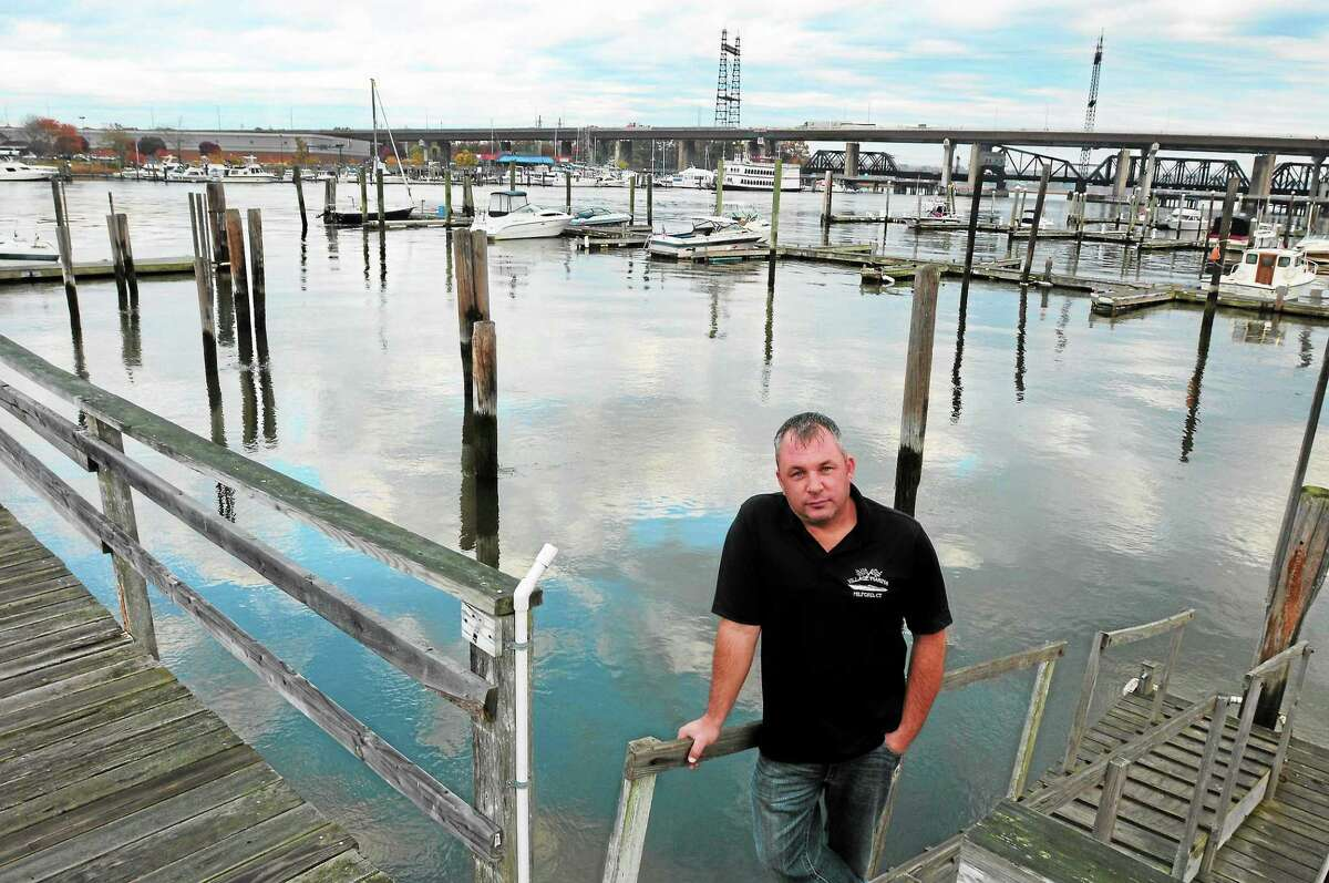 Dan Bagley, owner of Village Marina in Milford, stands in front of an empty space where docks used to be before being destroyed in Superstorm Sandy.