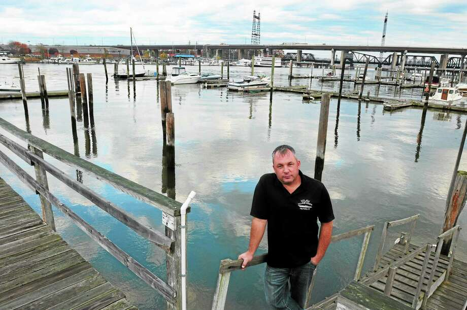 Dan Bagley, owner of Village Marina in Milford, stands in front of an empty space where docks used to be before being destroyed in Superstorm Sandy. Photo: Peter Hvizdak — New Haven Register            / ©Peter Hvizdak /  New Haven Register