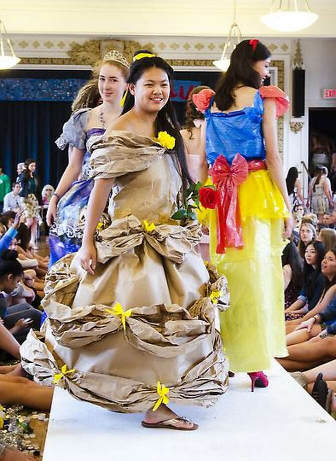Lauralton Hall students model clothing made from recycled materials at an eco-fashion show in Milford. Melanie Stengel/Register