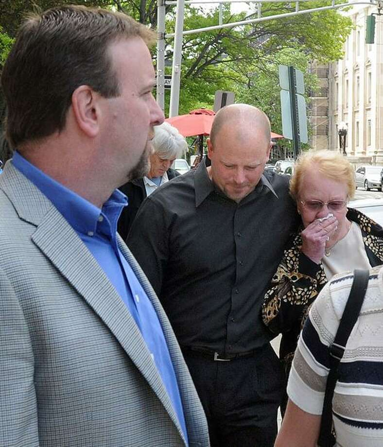 """Robert Hall Jr. left, his brother Donald center, and their aunt Joan leave New Haven Superior Court after the sentencing of Mary Ames in the murder of Christopher Hall, the men's brother. Mara Lavitt/New Haven Register <a href=""""mailto:mlavitt@newhavenregister.com"""">mlavitt@newhavenregister.com</a>5/17/13"""