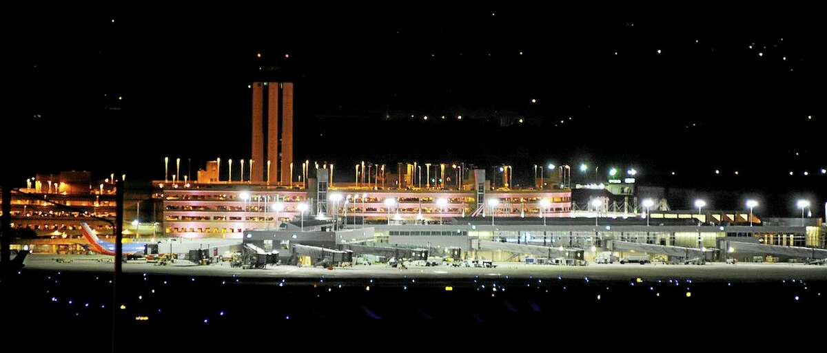 A threatening note found in a bathroom by an Birmingham-Shuttlesworth International Airport employee caused a shut down of the airport just after 4 p.m. Sunday Nov. 3, 2013. The terminal and tower were evacuated and flights were diverted. (AP Photo/The Birmingham News, Joe Songer)