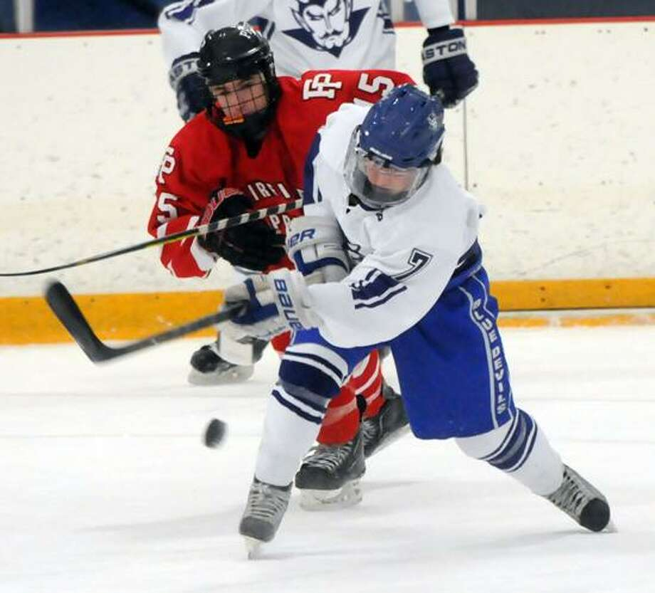Fairfield Prep at West Haven boys hockey, Bennett Rink. FP's Kenny Kochiss and WH's Kevin Coyle. Mara Lavitt/New Haven Register1/16/13