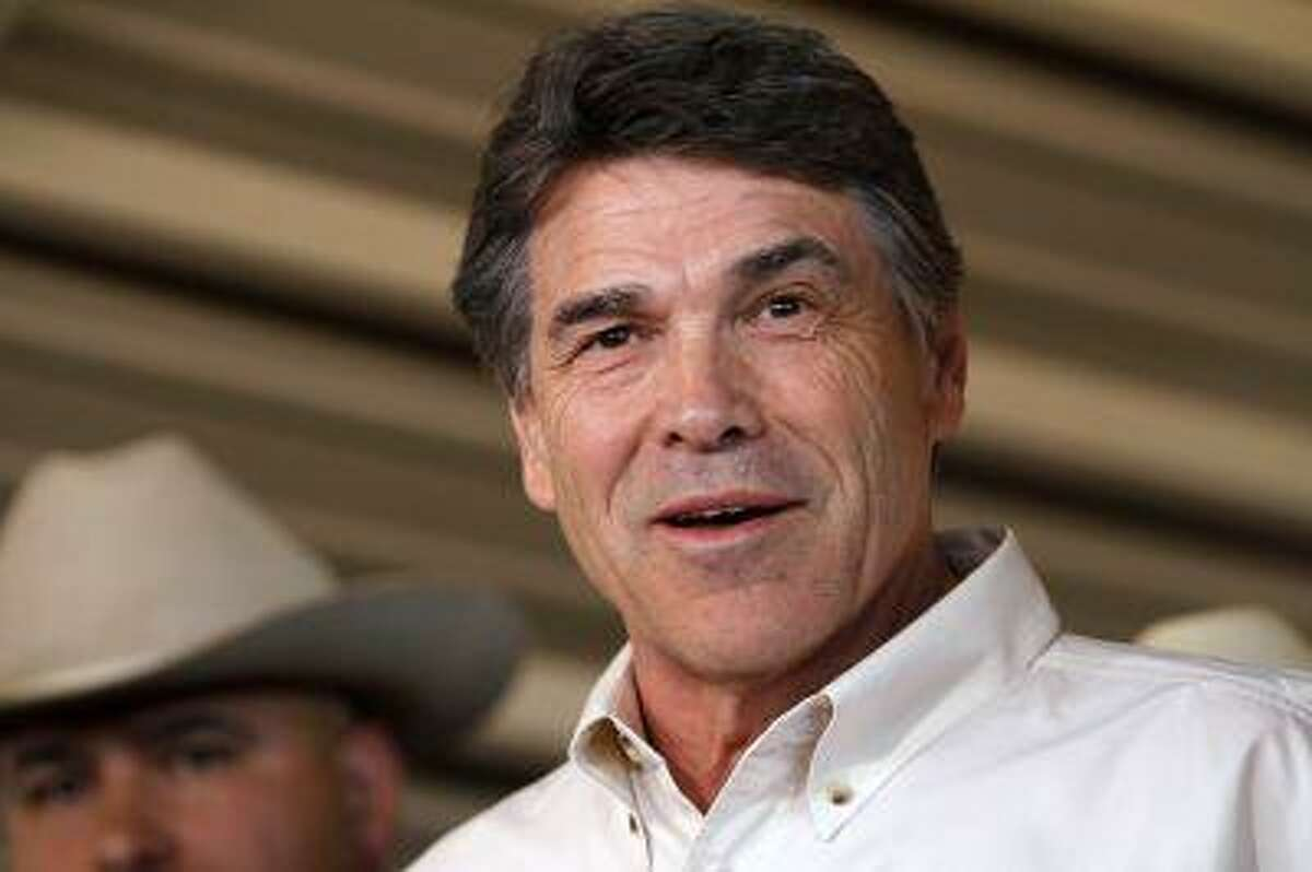Texas Governor Rick Perry answers questions from the media after taking an aerial tour over the fertilizer plant explosion site in West, Texas, April 19, 2013. (Jaime R. Cerrero/Reuters)
