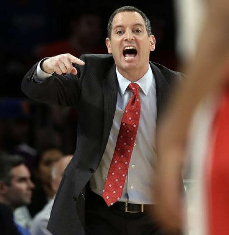In this Tuesday, March 12, 2013 photo, Rutgers head coach Mike Rice calls out to his team during the first half of an NCAA college basketball game against DePaul at the Big East Conference tournament, in New York. Rice was fired in early April 2013 for screaming at his players, calling them names, and kicking and shoving them.