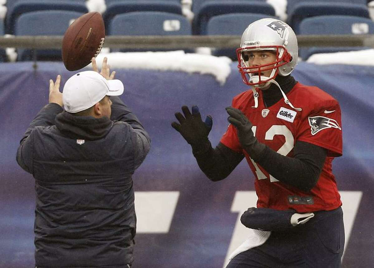 New England Patriots quarterback Tom Brady (12) works a drill during practice at the NFL football team's facility in Foxborough, Mass., Wednesday, Jan. 16, 2013. The Patriots will play the Baltimore Ravens in the AFC Championship game for the second year in a row at Foxborough this Sunday. (AP Photo/Stephan Savoia)