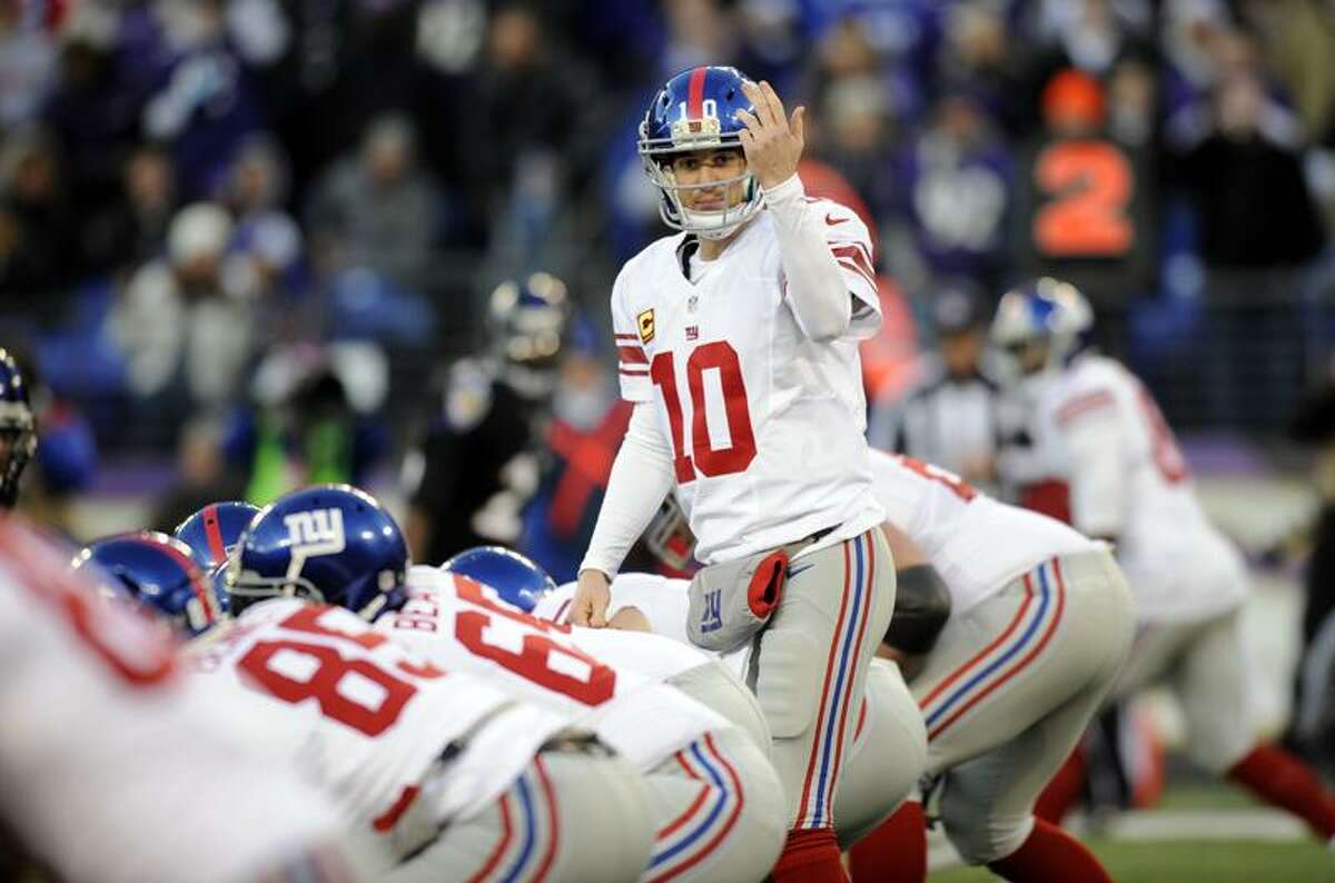New York Giants quarterback Eli Manning (10) prepares to run a play during an NFL football game against the Baltimore Ravens in Baltimore, Sunday, Dec. 23, 2012. (AP Photo/Nick Wass)