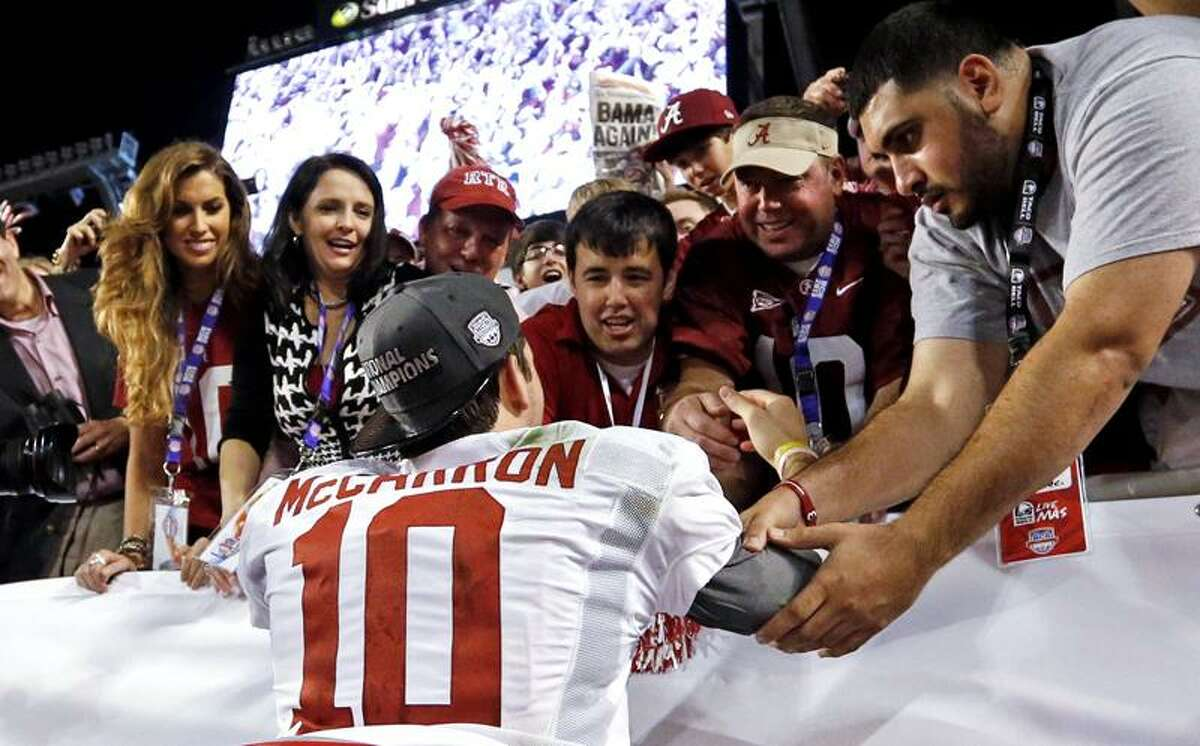 This Jan 7, 2013 file photo shows Katherine Webb, left, the girlfriend of Alabama quarterback AJ McCarron, and McCarron's mother, Dee Dee Bonner, second from left, watching McCarron celebrate after the BCS National Championship college football game. (AP Photo/John Bazemore)