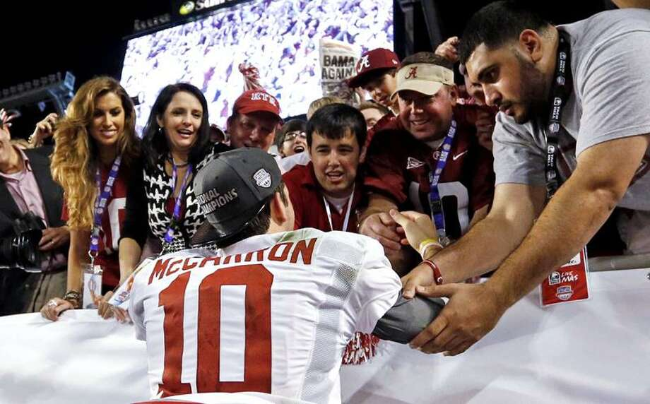 This Jan 7, 2013 file photo shows Katherine Webb, left, the girlfriend of Alabama quarterback AJ McCarron, and McCarron's mother, Dee Dee Bonner, second from left, watching McCarron celebrate after the BCS National Championship college football game. (AP Photo/John Bazemore) Photo: AP / AP2013