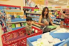 Elizabeth Salinas and her son Dylan Salinas shop for school supplies during the tax-free holiday Saturday Aug. 10, 2013 at Super Target. A new report from the Tax Foundation argues that states should eliminate tax-free holidays.