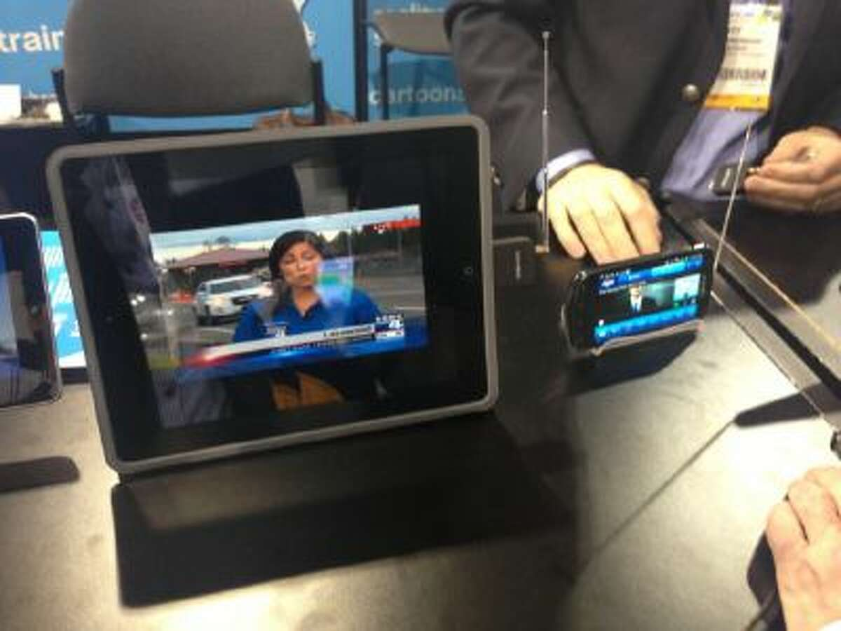 Mobile TV antenna attachments, known as dongles, are displayed at the NAB Show in Las Vegas on Wednesday, April 10, 2013. On the left, an EyeTV Mobile device made by Elgato, is attached to an iPad. On the right, the Samsung Galaxy S Lightray has an extendable antenna embedded in the device.