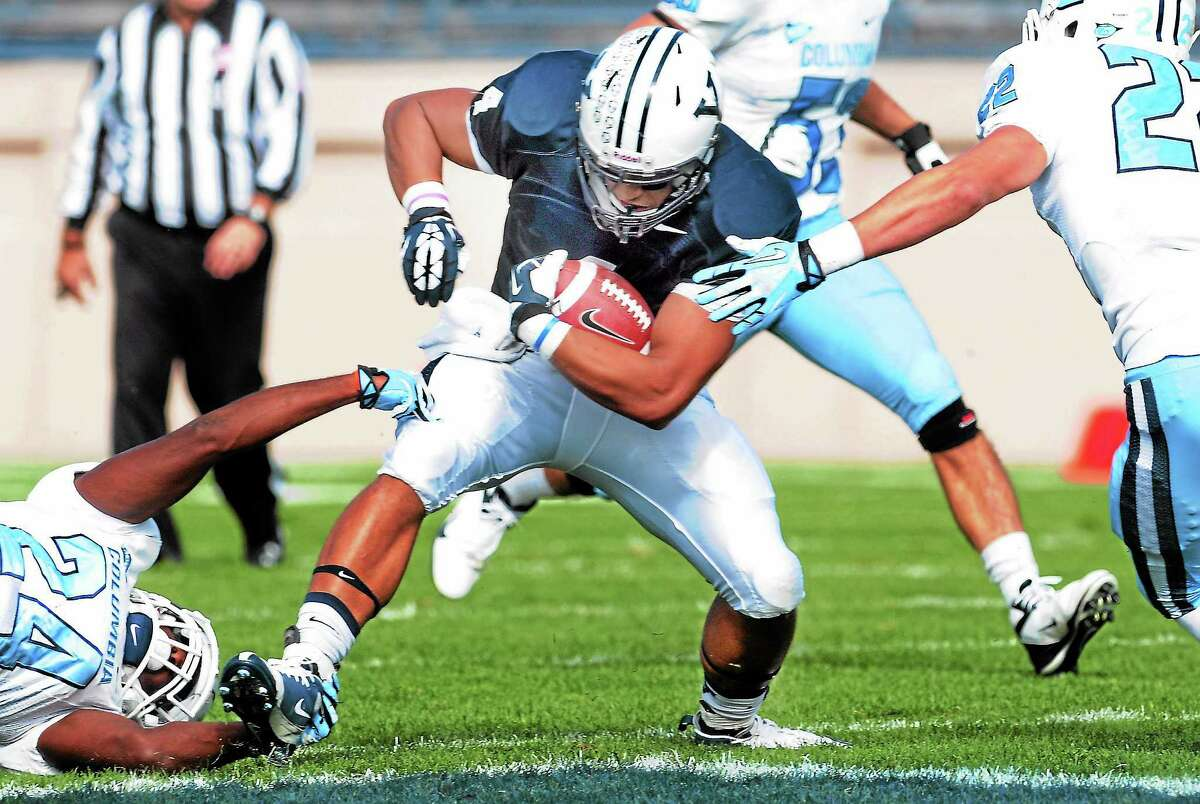Columbia's Marquel Carter and Brock Kenyon on Yale's Sebastian Little during Saturday's game. Yale beat Columbia 53-12.