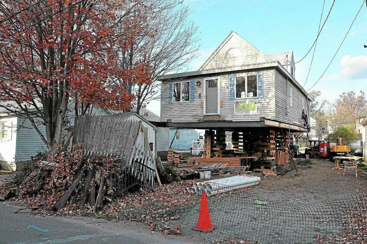 (Peter Casolino — New Haven Register) Homes along James Street in Milford damaged during storm Sandy. pcasolino@NewHavenRegister