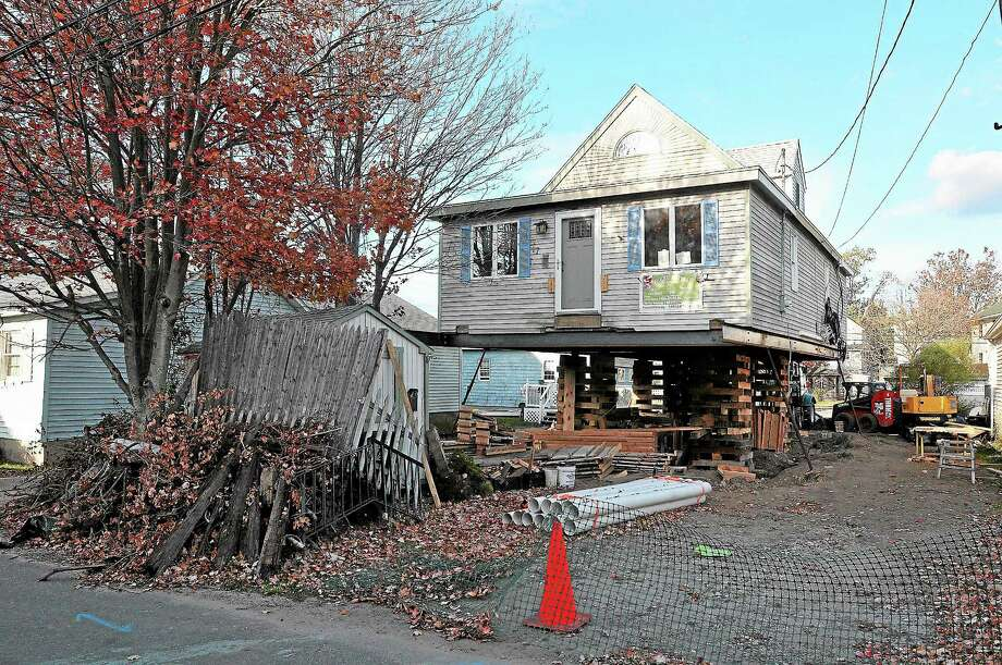 (Peter Casolino — New Haven Register)   Homes along James Street in Milford damaged during storm Sandy. pcasolino@NewHavenRegister Photo: Journal Register Co.