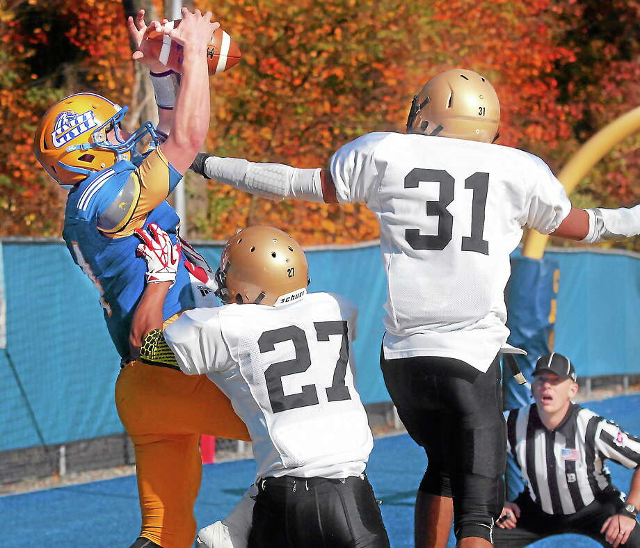 New Haven's Ronnie Nelson is unable to haul in a pass in the end zone during Saturday's game against AIC. Photo: Mara Lavitt — Register   / Mara Lavitt