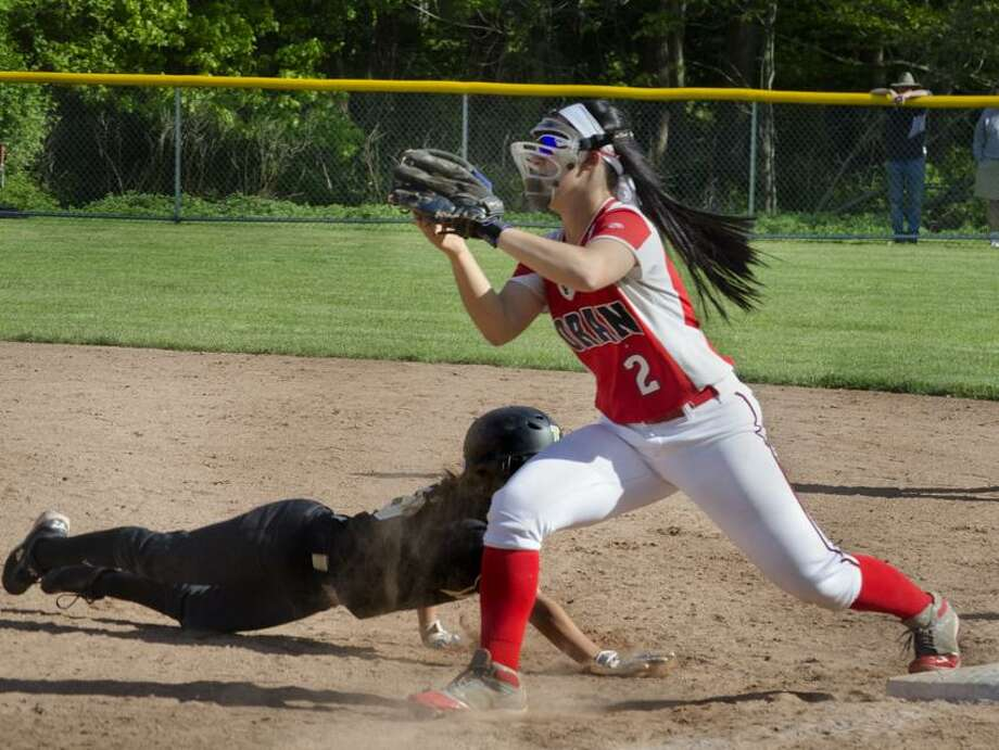 Law's Steph Peloso gets picked off first base by Foran's Ashley Mendillo.   Melanie Stengel/Register