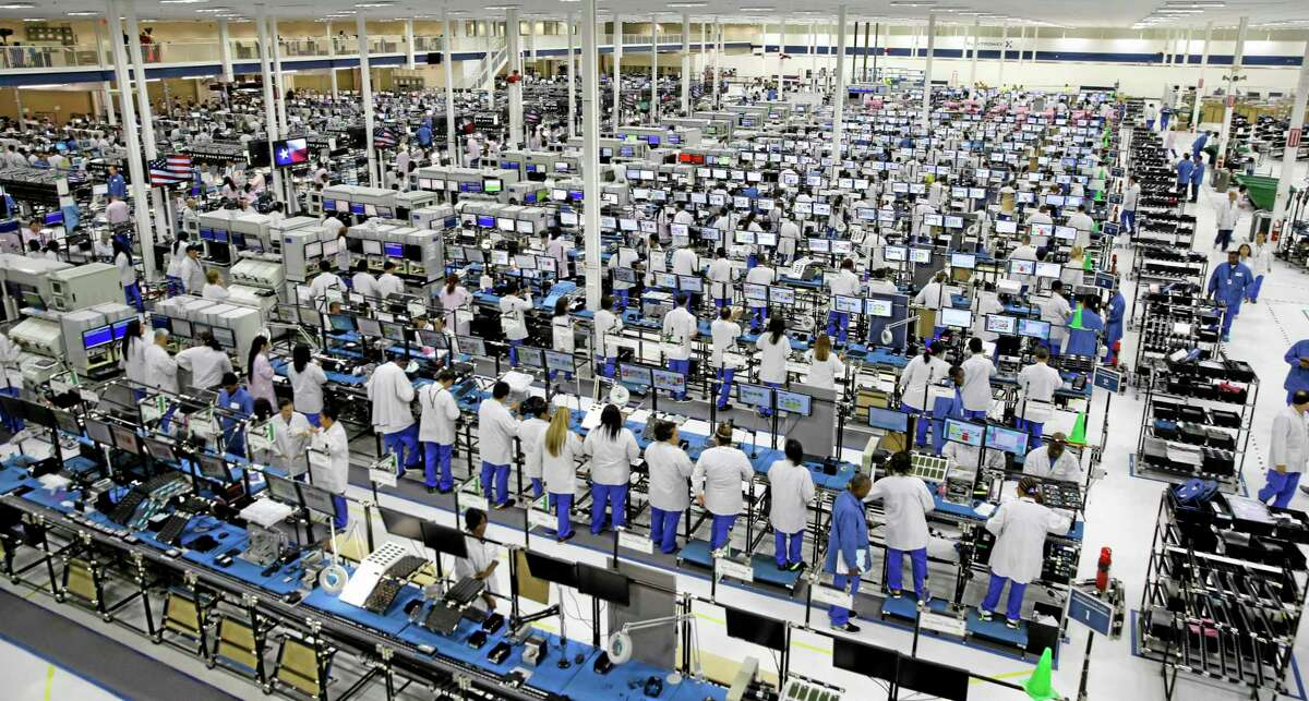 Workers man the Motorola smartphone plant in Fort Worth, Texas