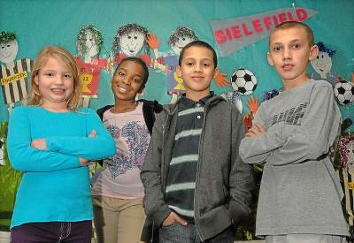 Catherine Avalone/The Middletown Press Lee Ann Roy, 9, fifth grader Ziara Jones, 11, Elyan Rivera, 10, and Mark Quinn, 10, left to right, are awarded the national Student POWER Award program sponsored by the National Association of School Psychologists (NASP) at Bielefield Elementary School in Middletown. According to school pyschologist, Eric Leaf, Mark, a fifth grader is recognized for embracing challenges and Ziara, also a fifth grade student is acknowledged for her hard work and effort. Fourth grade students, Elyan has been recognized for taking responsibility for his behavior and academics and Lee Ann, for kindness and concern for others.