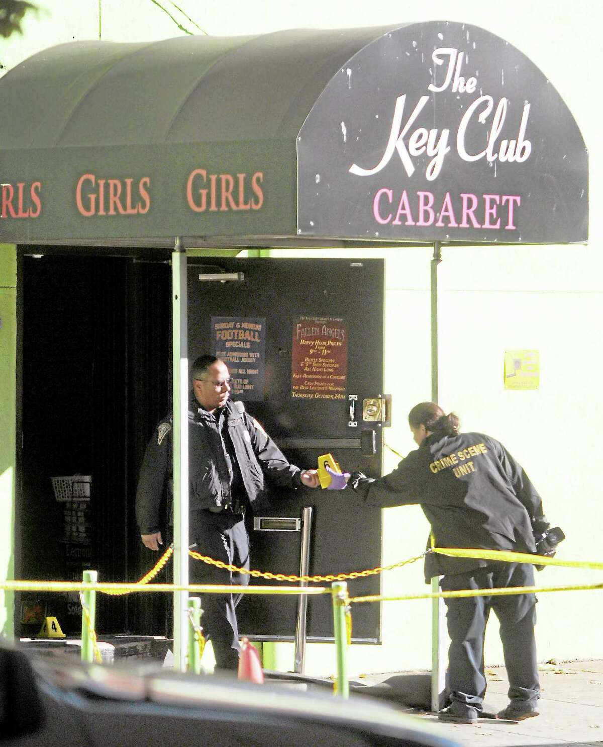 (Peter Hvizdak — Register)Saturday October 26, 2013(Peter Hvizdak — Register)New Haven Police investigate the crime scene were one woman is dead, two people are listed in critical condition and three are being treated for non-life threatening wounds and injuries after a shooting at the Key Club Cabaret at 85 Saint John St. Saturday October 26, 2013.
