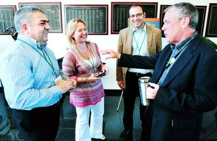 Arnold Gold/New Haven Register Subway Global Challenge winners Andreas Chiou (left) of Greece and Holger Staerz (center right) of Austria speak with Jennifer Kushell (center left), president of the Young Entrepreneurs Network, and Don Fertman (right), Chief Development Officer for Subway, at Subway World Headquarters in Milford on 7/8/2013.