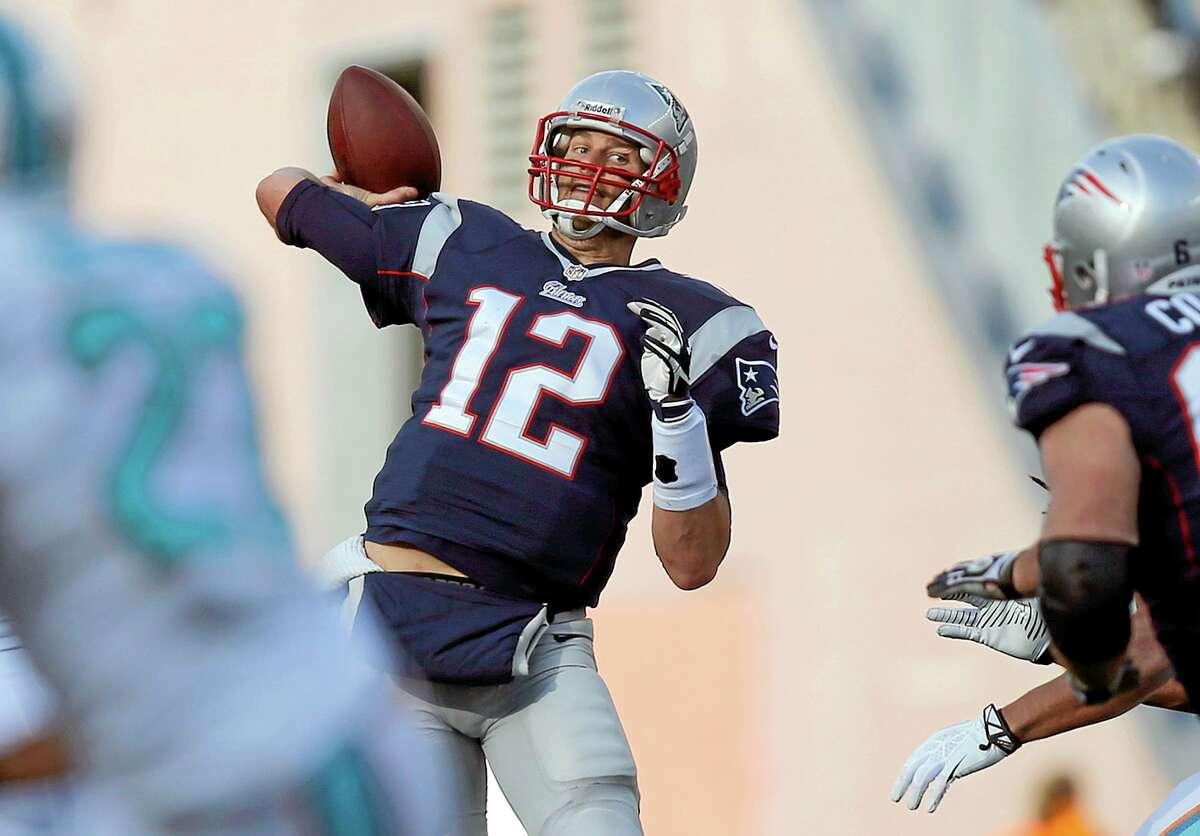 New England Patriots quarterback Tom Brady passes against the Miami Dolphins in the second half Sunday.