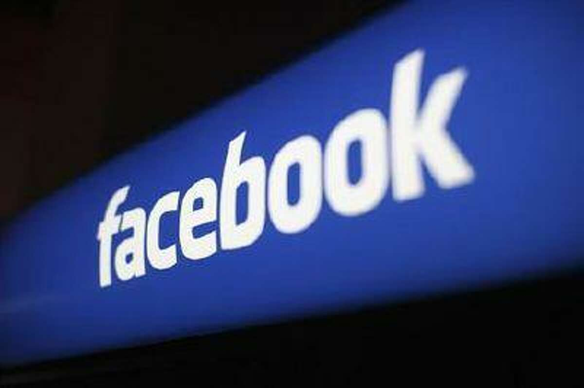 The Facebook logo is pictured at the Facebook headquarters in Menlo Park, California January 29, 2013.