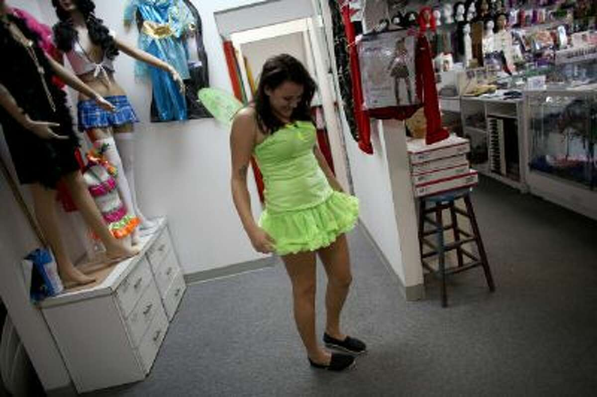 Sarah Helton puts together a Halloween costume at Dixon Costumes, Inc on October 23, 2013 in Miami, Florida.