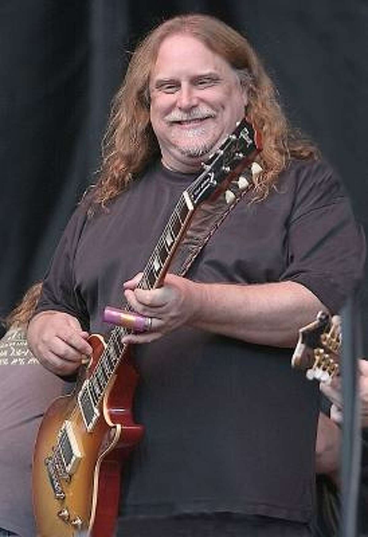 Guitarist, singer and songwriter Warren Haynes, founder of Gov't Mule and long time member of the Allman Brothers Band, is shown on stage performing during Mountain Jam in Hunter, New York.