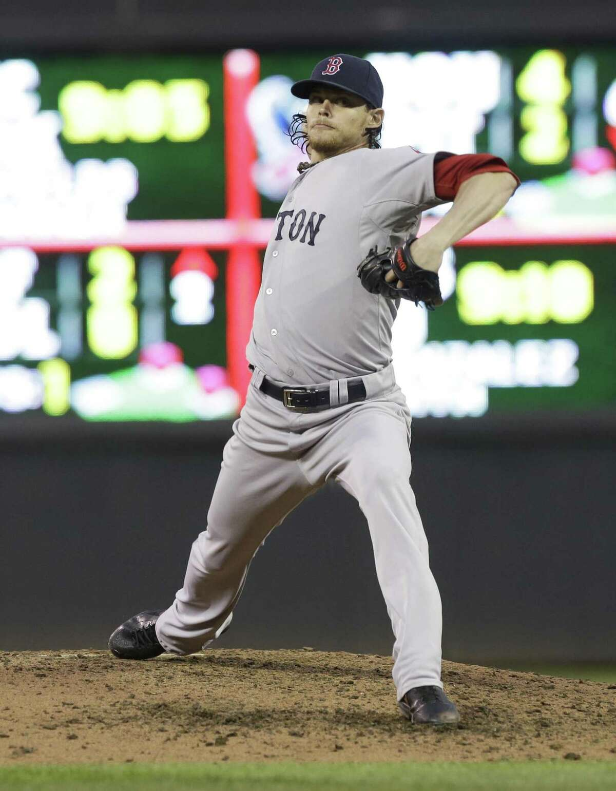 Boston Red Sox pitcher Clay Buchholz throws against the Minnesota Twins in the fourth inning of a baseball game, Friday, May 17, 2013, in Minneapolis. (AP Photo/Jim Mone)