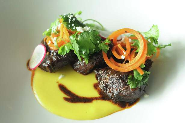 The fried pork cheek on corn puree with cilantro and carrot salad at Peska on Post Oak Blvd. Tuesday July 25, 2017. (Dave Rossman Photo)
