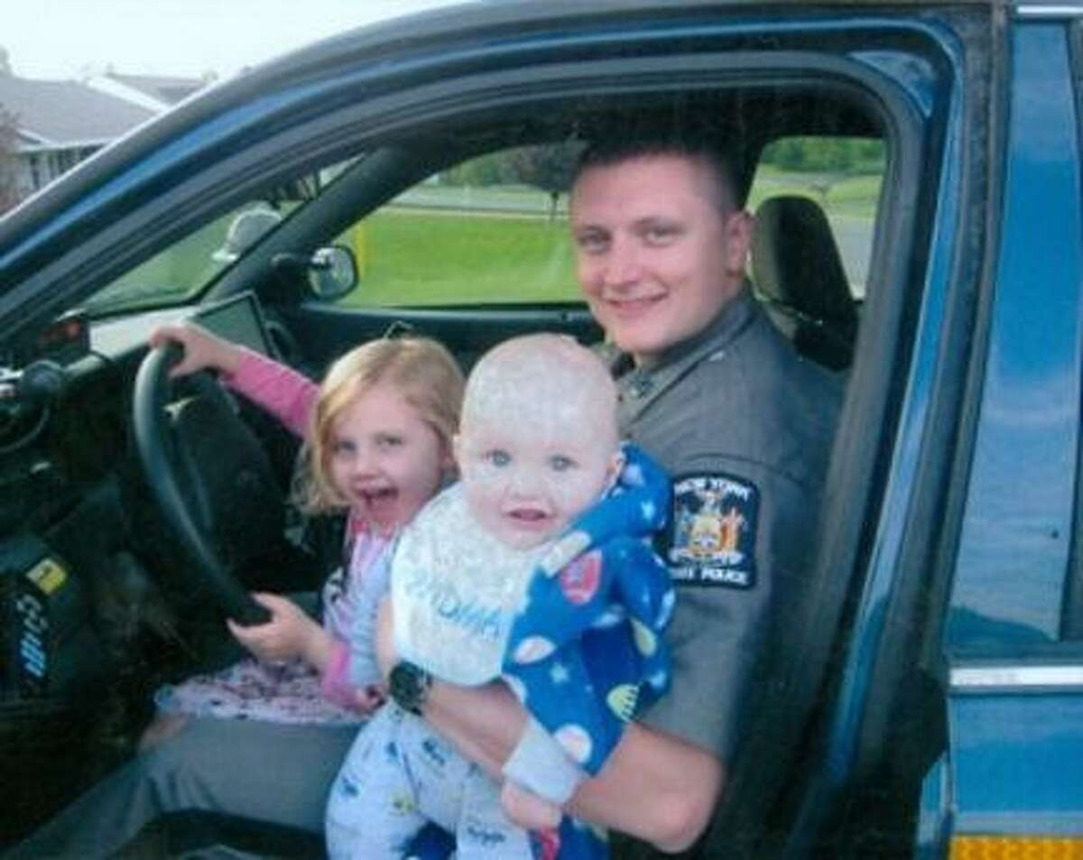 Submitted Photo Tim Tyler, right, sits in his car with his daughter Emma, left, and son Andrew.