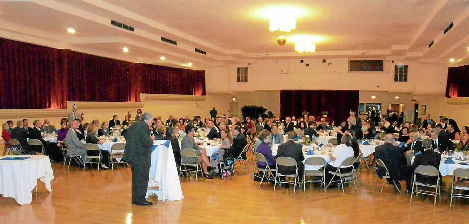 Kurt Wanfried-The Oneida Daily Dispatch @OneidaEditor on TwitterEmcee Mike Healy talks to the assembled crowd of about 180 at Friday evening chamber dinner. Photo: Journal Register Co.