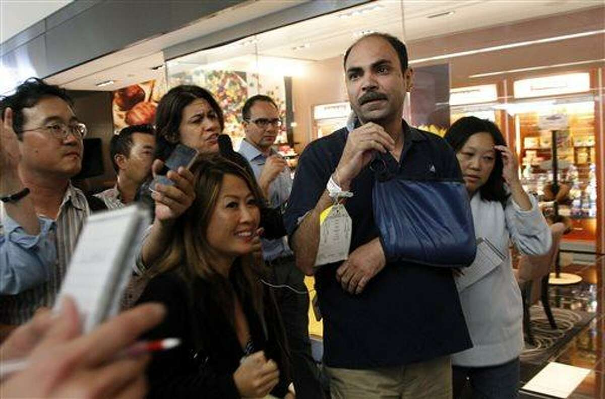 Asiana Flight 214 passenger Veddpal Singh talks to reporters after the plane crashed at San Francisco International Airport in San Francisco, Saturday, July 6, 2013. (AP Photo/Bay Area News Group, LiPo Ching)