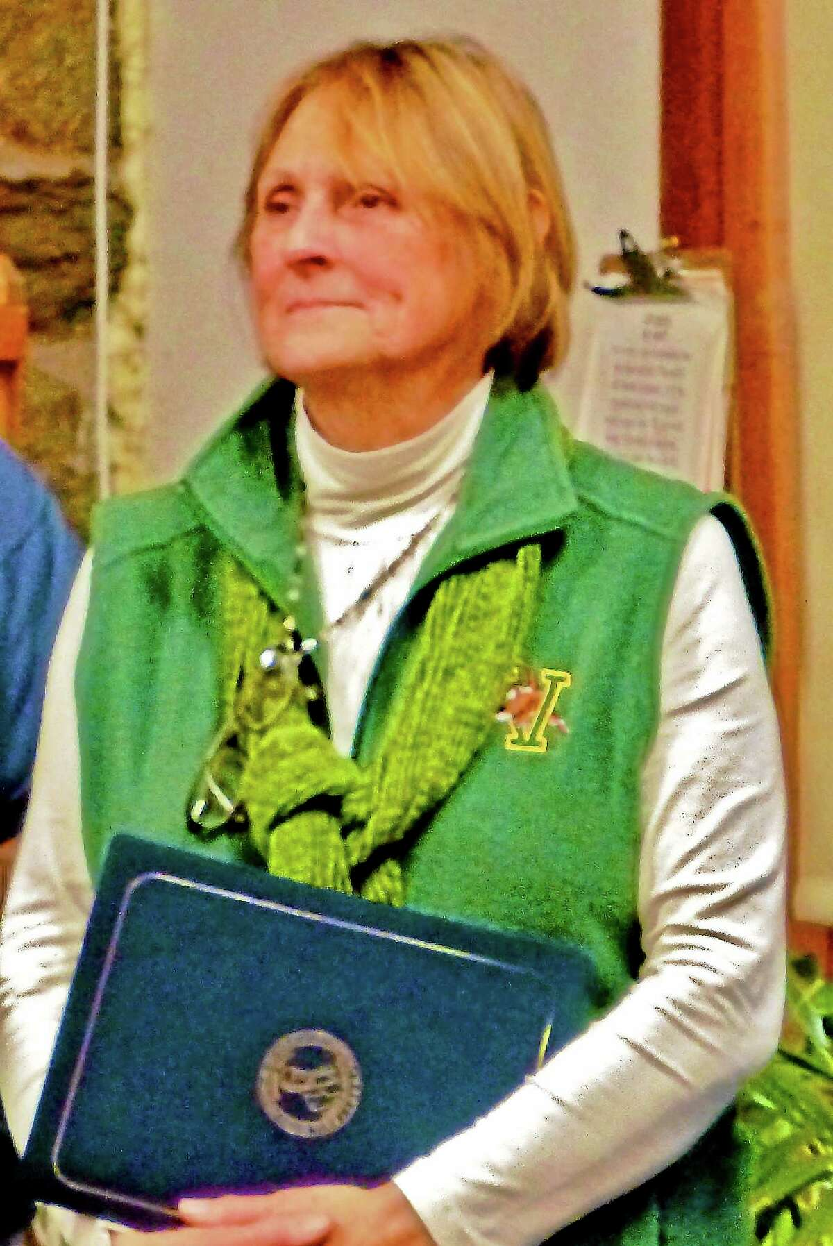 Patricia Villers/Register Donna Lindgren, retiring Ansonia Nature and Recreation Center director, listens as friends describe her legacy.