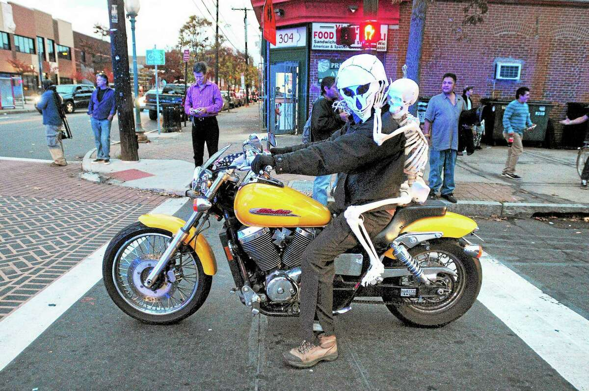 Jason Wright of New Haven leads the Day of the Dead parade as it turns onto Grand Avenue in Fair Haven Saturday.