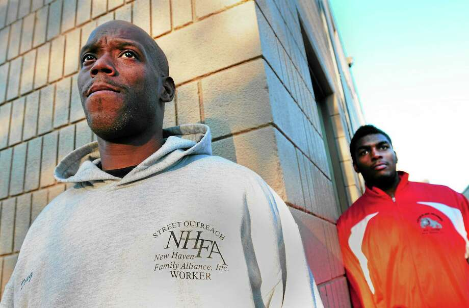 (Peter Hvizdak — Register) Doug Bethea of New Haven, street outreach worker and director of the Nation Drill Squad and Drum Corps, left, has kept Khalid Fleming of New Haven, 20, out of trouble, according to Fleming, a member of Bethea's drum corps. Bethea says that mentorship from other black men is one way to reduce city gun violence. Photo: New Haven Register / ©Peter Hvizdak /  New Haven Register