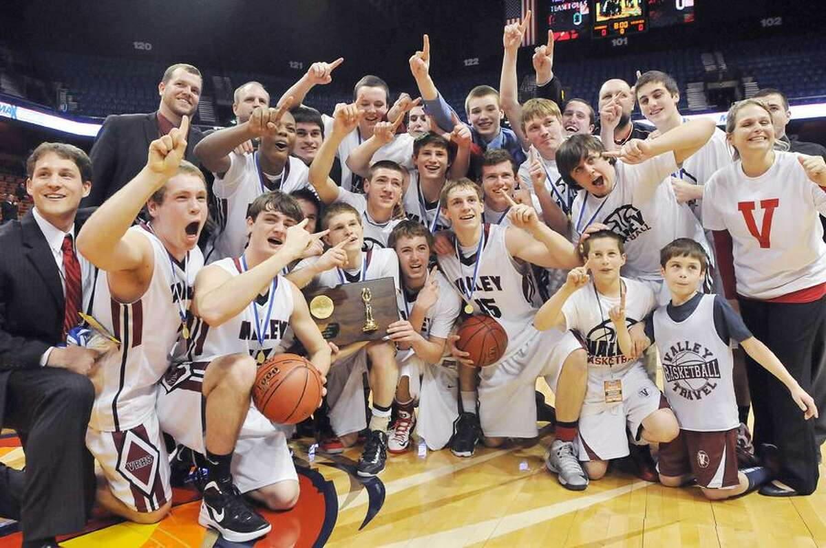 Catherine Avalone/The Middletown Press Class M State Champions, the Valley Regional Warriors following their win over the Weston Trojans 52-45 Friday night at Mohegan Sun.