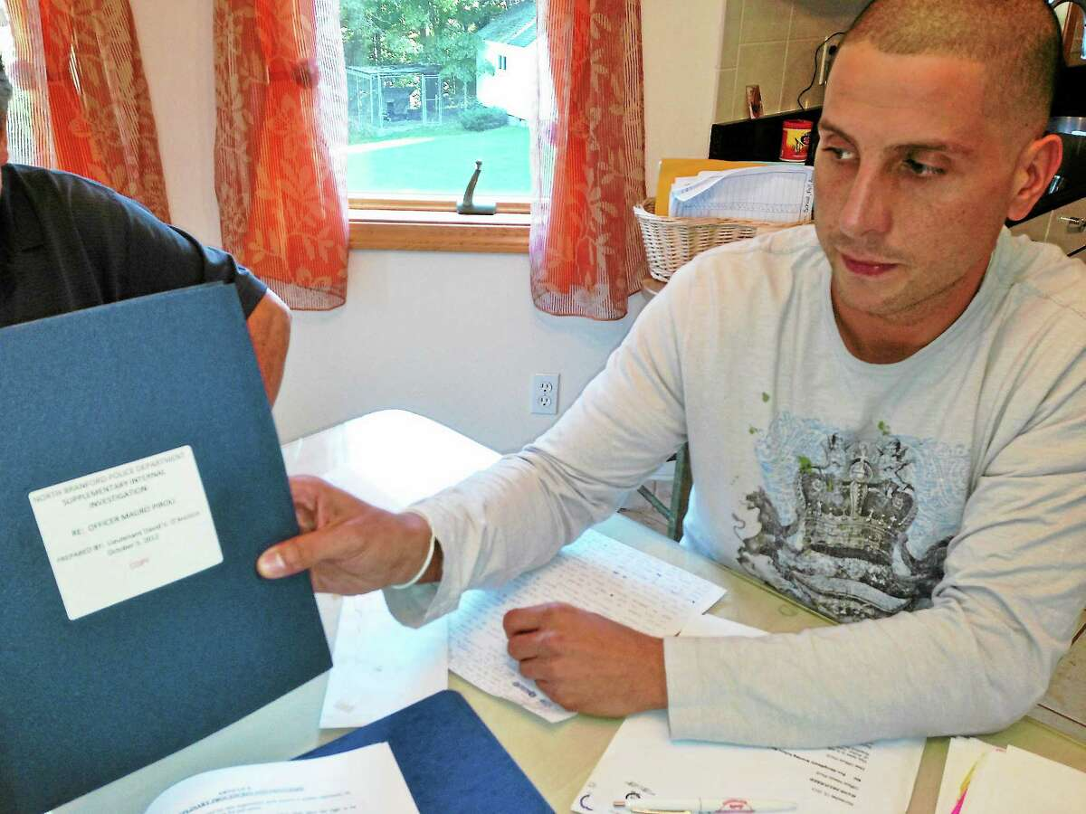 JOE AMARANTE — NEW HAVEN REGISTER Mauro Piroli of North Branford displays a copy of the investigation, dated in October 2012, that he says he didn't see until just before his December firing.