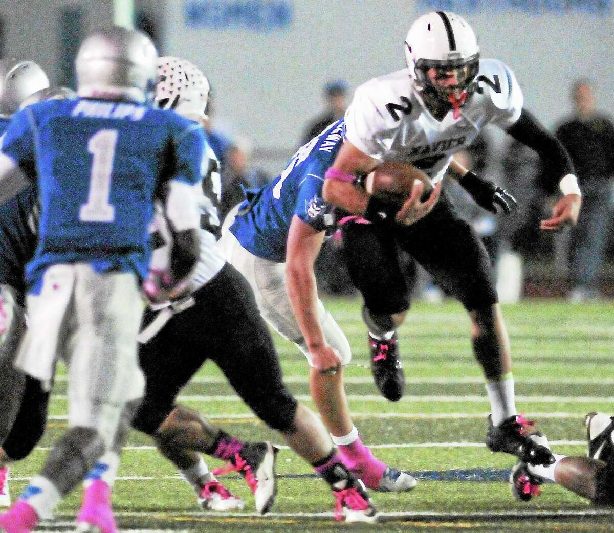 (Peter Hvizdak — Register)Xavier Quarterback Joseph Carbone breaks through the hole for a gain against West Haven H.S.during first quarter football action at West Haven High School Friday evening October 18, 2013.