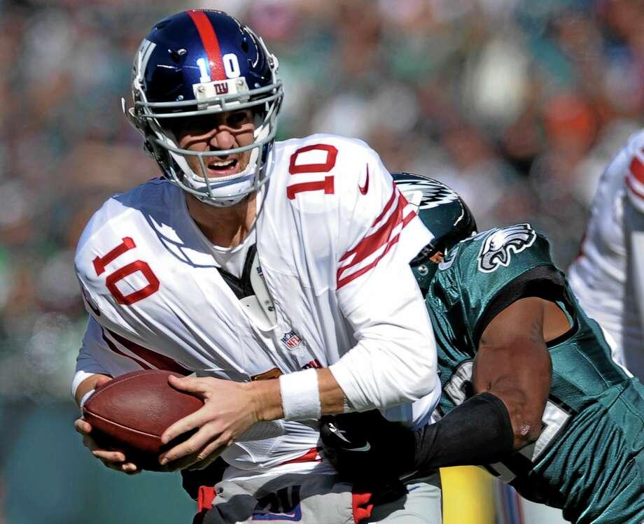 Giants quarterback Eli Manning has been one of the tricks this fantasy football season. Photo: Michael Perez — The Assocaited Press   / FR168006 AP