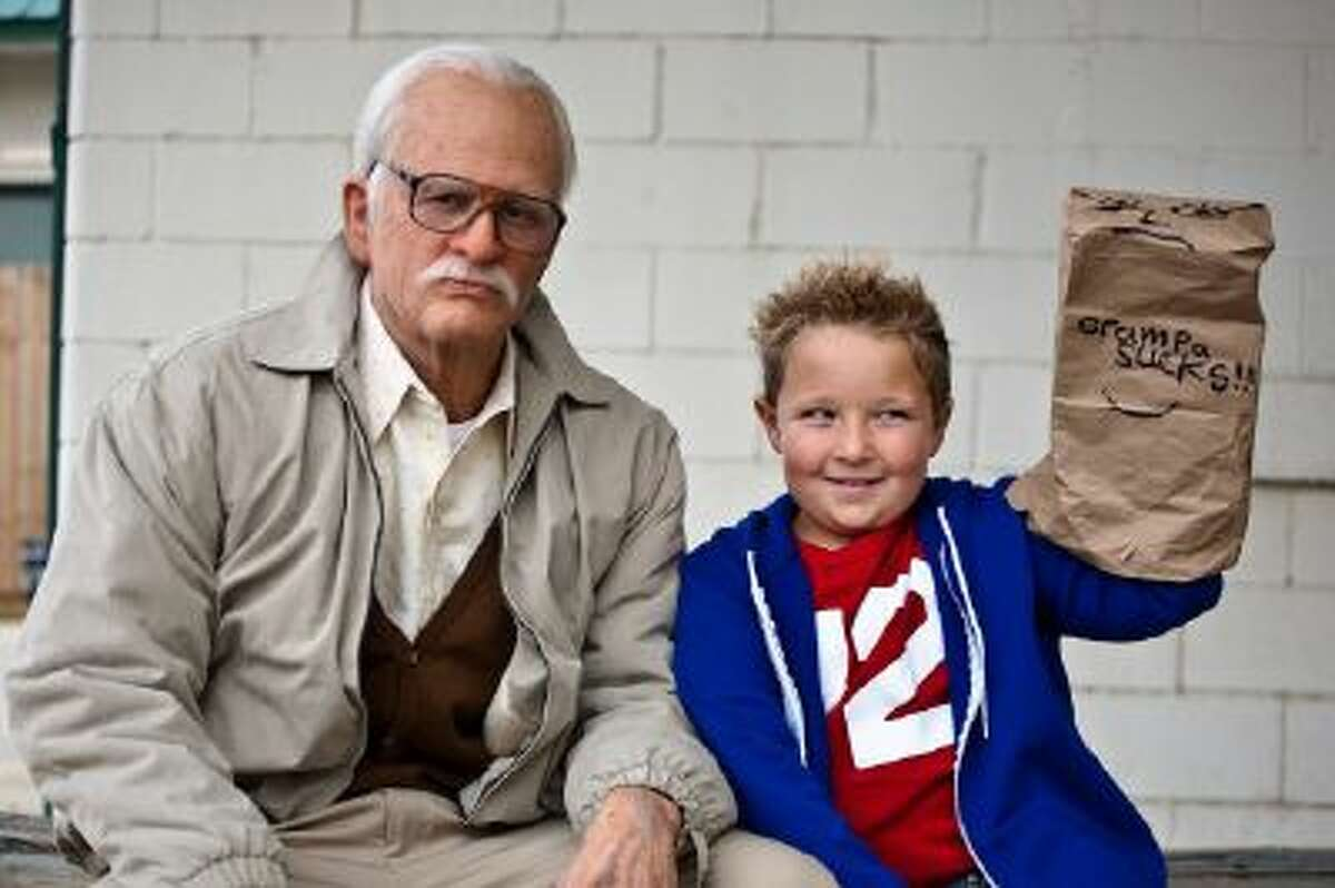 """This photo released by Paramount Pictures shows Johnny Knoxville, left, as Irving Zisman and Jackson Nicoll as Billy in """"Jackass Presents: Bad Grandpa,"""" from Paramount Pictures and MTV Films."""