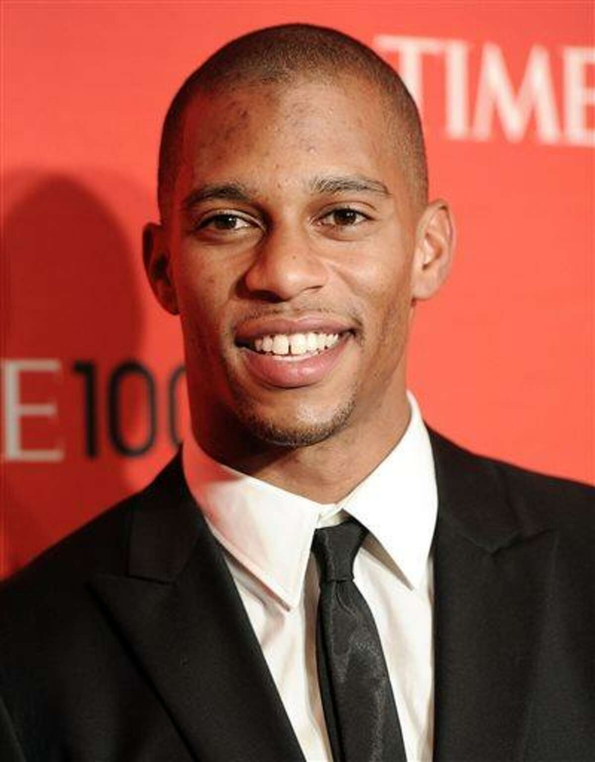 File-This April 24, 2012 file photo shows New York Giants football player Victor Cruz attending the TIME 100 gala, celebrating the 100 most influential people in the world, at the Frederick P. Rose Hall in New York. Cruz has signed a five-year contract extension that runs through the 2018 season. The deal with worth $43 million according to media reports Monday July 8, 2013. Cruz was a restricted free agent with three years in the NFL. Last month, he signed a one-year, $2.879 million tender with the Giants, but a long-term deal was already in the works. The Giants could have matched any offers Cruz received from other teams, so he didn't get any. (AP Photo/Evan Agostini,File)