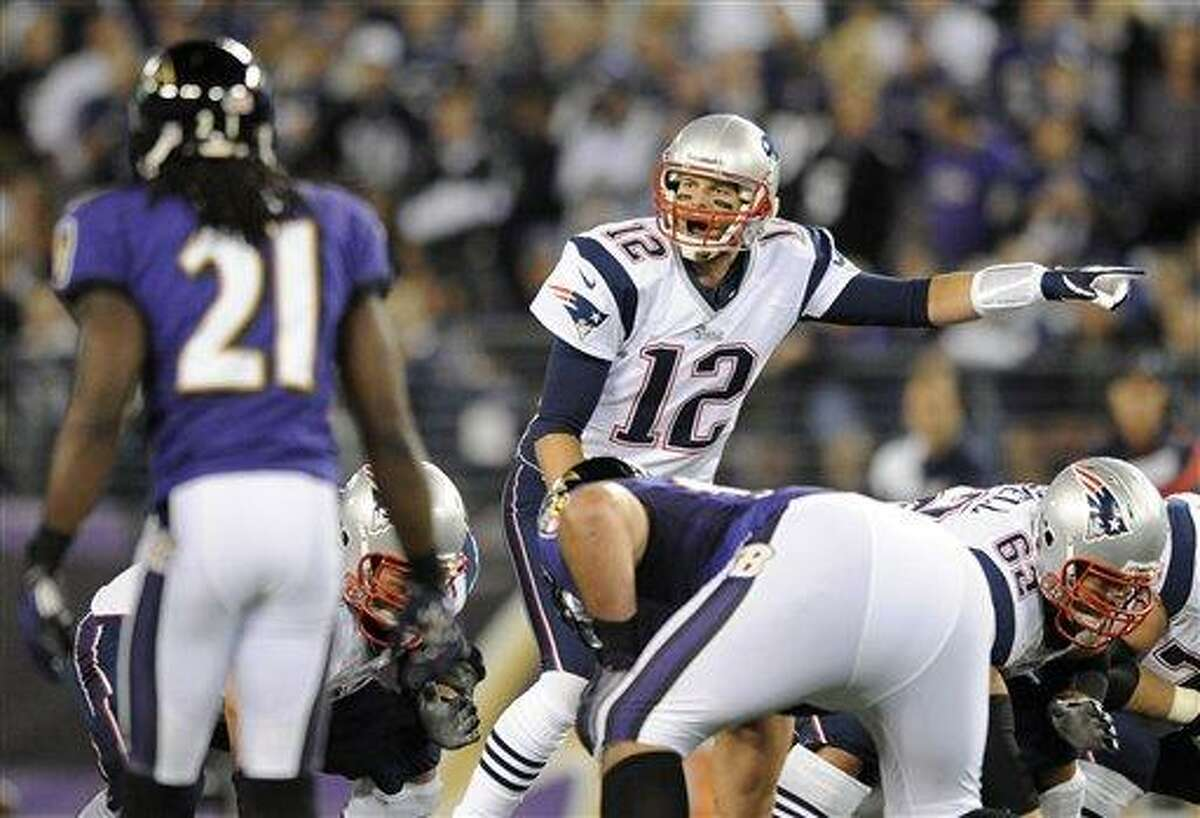 FILE - In this Sept. 23, 2012 file photo, New England Patriots quarterback Tom Brady (12) points across the line of scrimmage in the first half of an NFL football game against the Baltimore Ravens in Baltimore. Brady's passing rating is lower against the Ravens than against any other team. The Ravens and Patriots meet in the AFC Championship game on Sunday, Jan. 20, 2013. (AP Photo/Nick Wass, File)