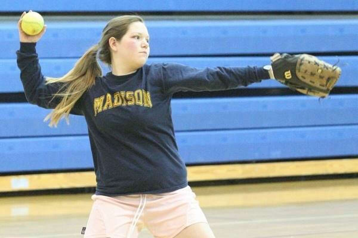 John Haeger @OneidaPhoto on Twitter/Oneida Daily Dispatch Madison's Ashely Russell makes the throw from third to first during a practice in Madison on Friday, March 15, 2013.