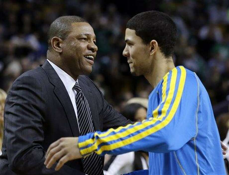 Boston Celtics head coach Doc Rivers, left, greets his son, New Orleans Hornets shooting guard Austin Rivers, prior to an NBA basketball game in Boston, Wednesday, Jan. 16, 2013. (AP Photo/Elise Amendola) Photo: ASSOCIATED PRESS / AP2013