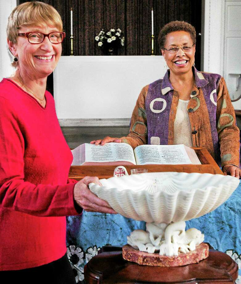 (Melanie Stengel — New Haven Register) Pastor Rochelle Stackhouse (L) and Assoc. Pastor Marilyn Kendrix stand with the baptismal font from the original congregation of New Haven's Church of the Redeemer 10/24. The  congregation is about to celebrate the 175th anniversary of the church. Photo: Journal Register Co.