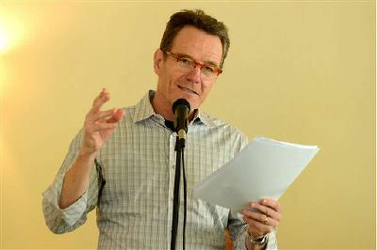 """Bryan Cranston reads from """"The Magiker,"""" by Charles Dennis, in The Caribou Room at Sportsmen's Lodge on Tuesday, Oct. 22, 2013, in Studio City, Calif."""