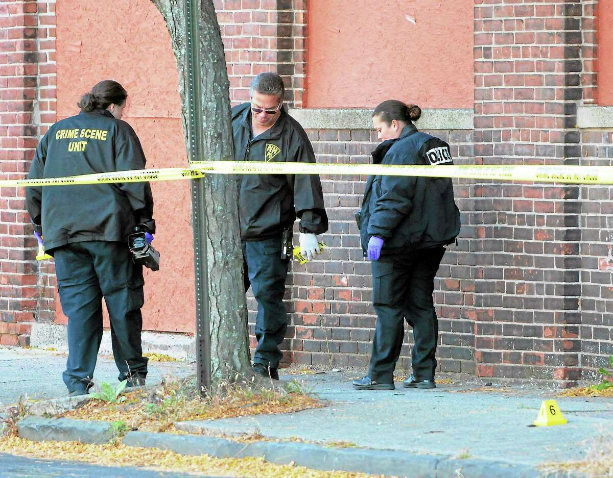 (Peter Hvizdak — Register)Saturday October 26, 2013(Peter Hvizdak — Register)New Haven Police investigate the crime scene where one woman is dead, two people are listed in critical condition and three are being treated for non-life threatening wounds and injuries after a shooting at the Key Club Cabaret at 85 Saint John St. near Hamilton St. Saturday morning October 26, 2013.