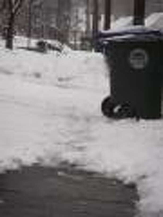 Photos by Nikki Treleaven Residents want the city to clear the raods of snow, but not by dumping it onto their sidewalks and driveways.