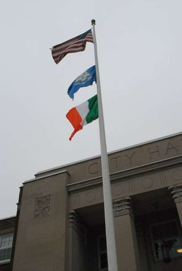The Irish flag flies above Torrington's city hall on St. Patrick's Day 2012. File photo.