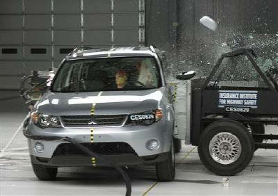 A side crash of a 2008 Mitsubishi Outlander. A report released Thursday, May 16, 2013, shows only two of 13 small SUVs are getting passing grades in front-end crash tests done by an insurance industry group. Photo: AP / IIHS